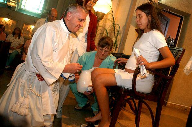 A Francis Washes Womans Feet