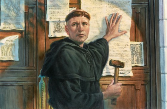 Luther posting 95 theses 560x366