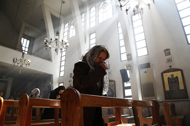 woman praying in a church in middle east
