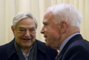 "George Soros and his old buddy, Sen. John McCain, have an important message for you: ""The Russians are coming! The Russians are coming!"""