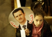 "Syrian girl brings Assad's image, with slogan ""We're all With You"", to Mass at her Greek Orthodox church"