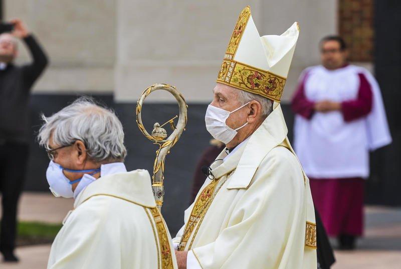 bishop in mask
