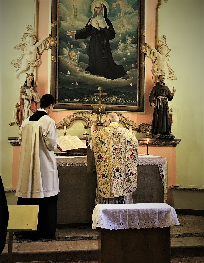 vigano offering Latin Mass