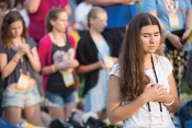 Pilgrims pray during the July 26 opening Mass for World Youth Day in Kraków, Poland. (CS photo by Jaclyn Lippelmann)